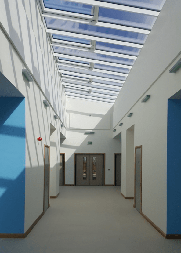 Wide bright corridor with glass ceiling